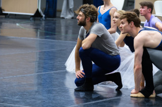 Giorgio Garrett, Barry Drummond and Artists of English National Ballet listen to instructions during Cinderella Rehearsals.